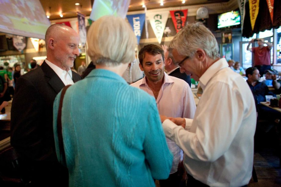After voting in favor of the Seattle Arena MOU, Councilmember Sally Bagshaw talks to Seattle Arena investor Chris Hansen, a Hansen advisor and Councilmember Seattle Arena MOU at F.X. McRory's during the Chris Hansen Buys Fans A Beer event. (September 13, 2012)